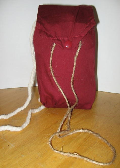 Your bag is complete!  You can draw the chord tight to protect the yarn and snap the flap closed.